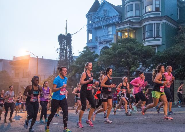 As the sun rises, runners make their way to Golden Gate Park where they'll encounter more hilly terrain.