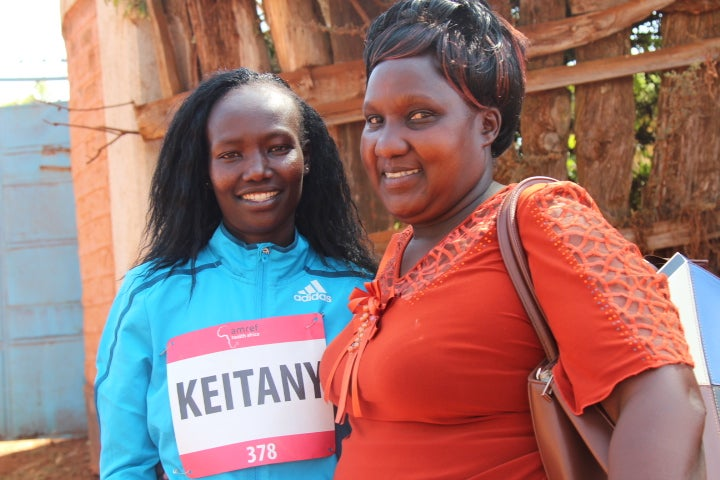 Mary Keitany (left) with midwife Elizabeth Ndunge Mphale, who has worked as a midwife for more than 30 years.
