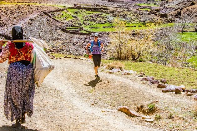 Allison runs past village women on High Atlas trail