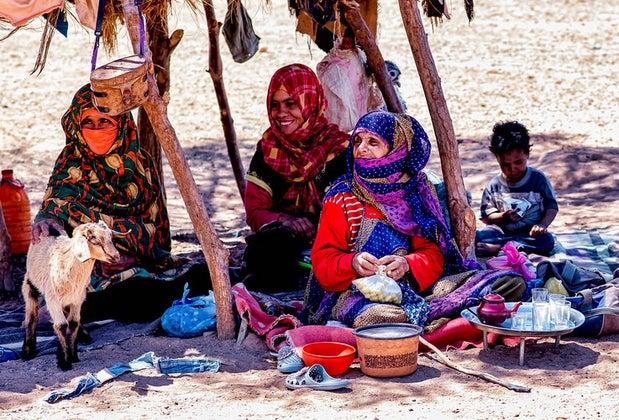 Berber nomad women preparing tea