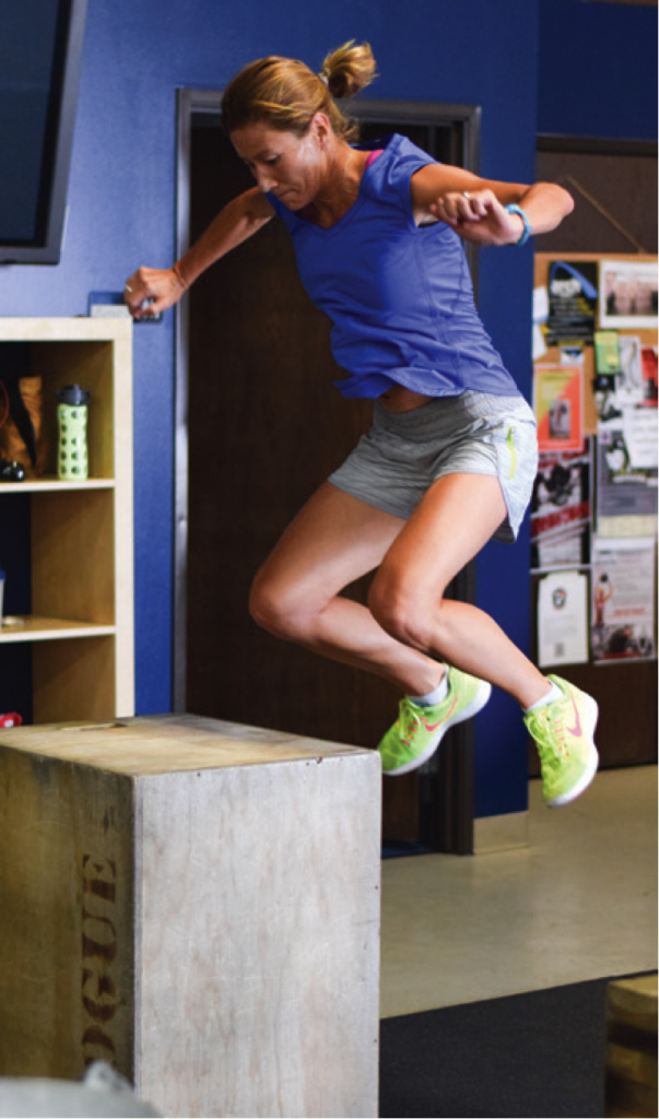 Author Lisa Jhung doing box jumps.