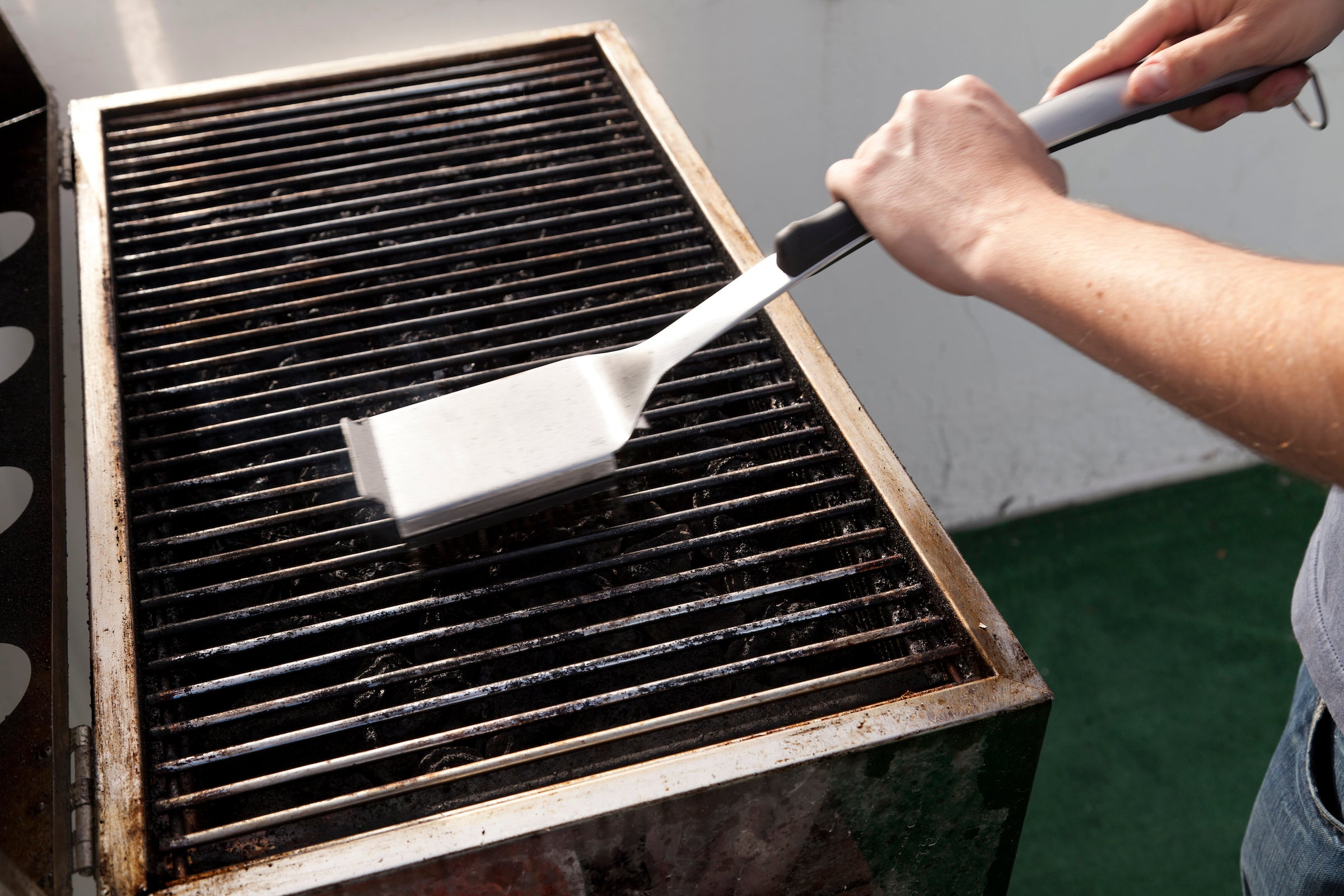 cleaning the grill before use