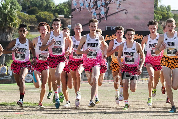 8a2ad0b19 Male high school runners break from the starting line at the 2017 Foot  Locker Cross Country National Championships.