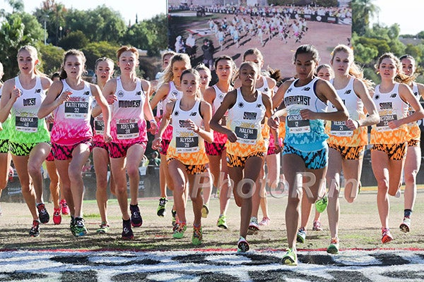 912982900 Female high school runners break from the starting line at the 2017 Foot  Locker Cross Country National Championships.