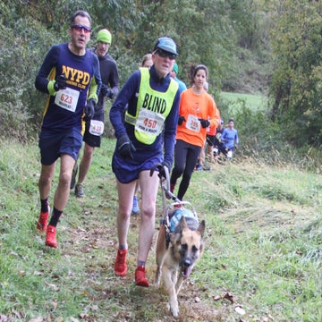 Trust Is Key For This Blind Runner And Her Dog