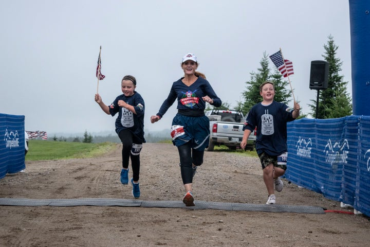 Wreaths Across America Cathy Powers runs with the two grandchildren of Wreaths Across America founders, Miles and Lola.