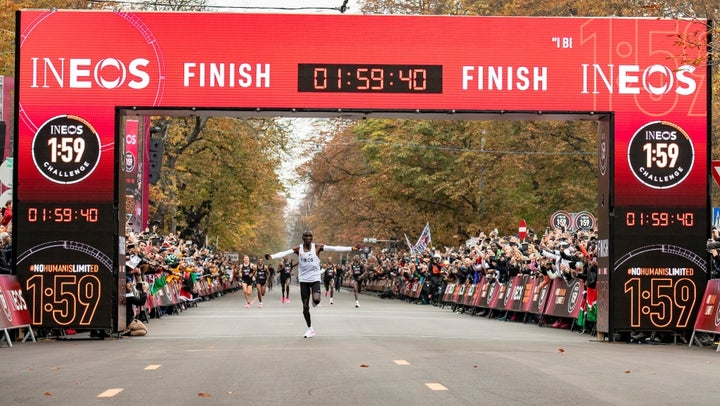Eliud Kipchoge celebrates as he crosses finish line and makes history to become the first human being to run a marathon in under 2 hours.
