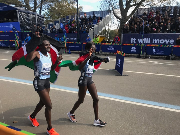 Joyciline Jepkosgei and Mary Keitany celebrate their first and second place finishes at the 2019 New York City Marathon.