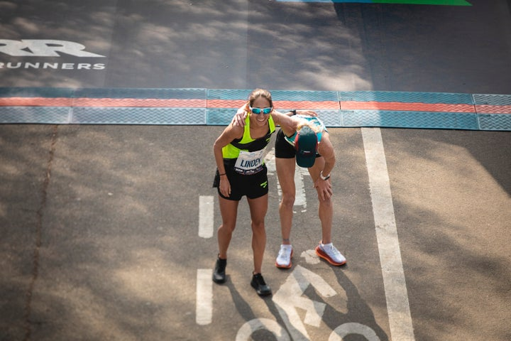 Desiree Linden and Kellyn Taylor celebrate at the 2019 New York City Marathon finish line.