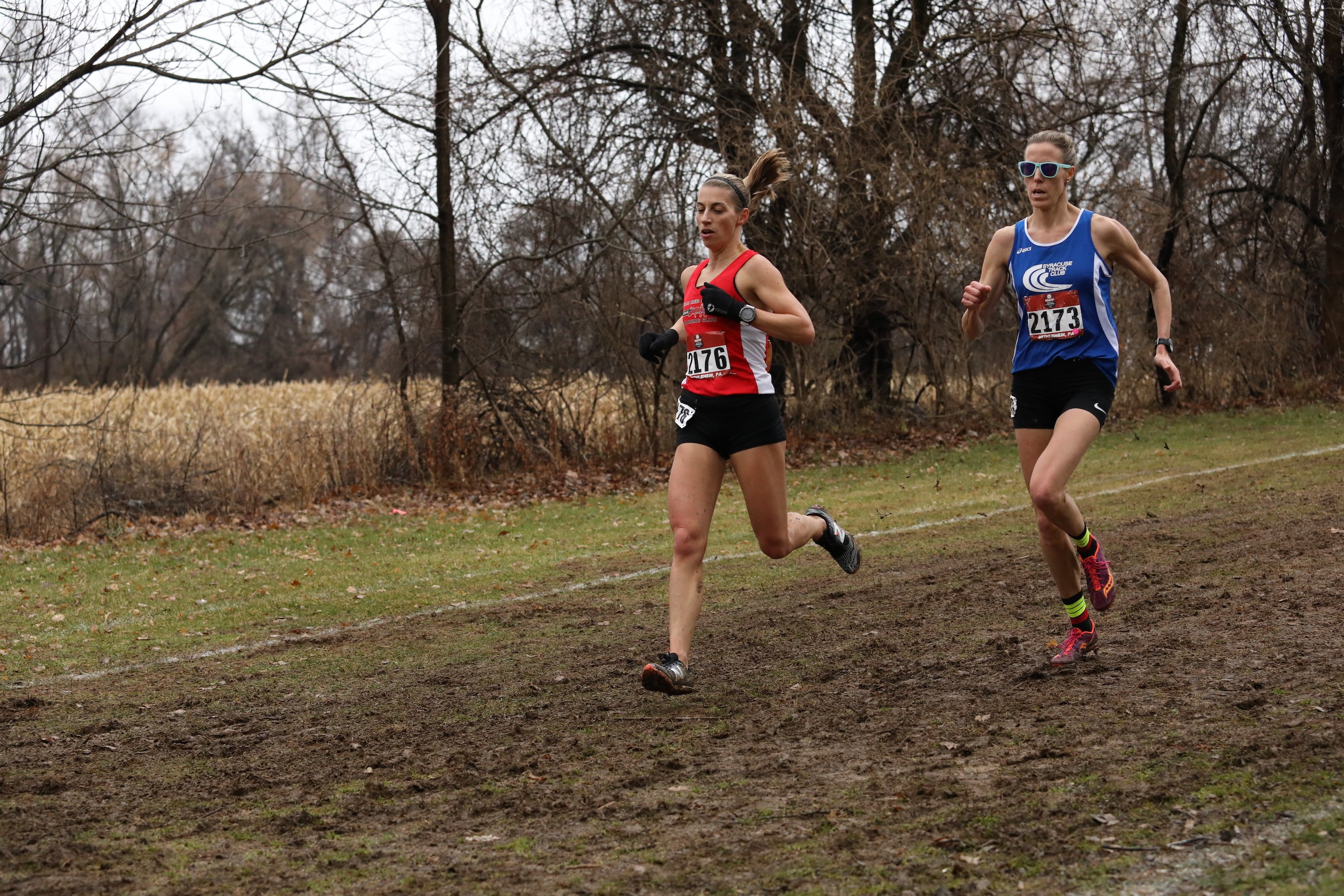 Eventual 2019 USATF Club Cross Country Championships masters division winner Sascha Scott of Syracuse battles through the mud against Casey Hire, 40, from Team Red Lizard, who placed fourth.