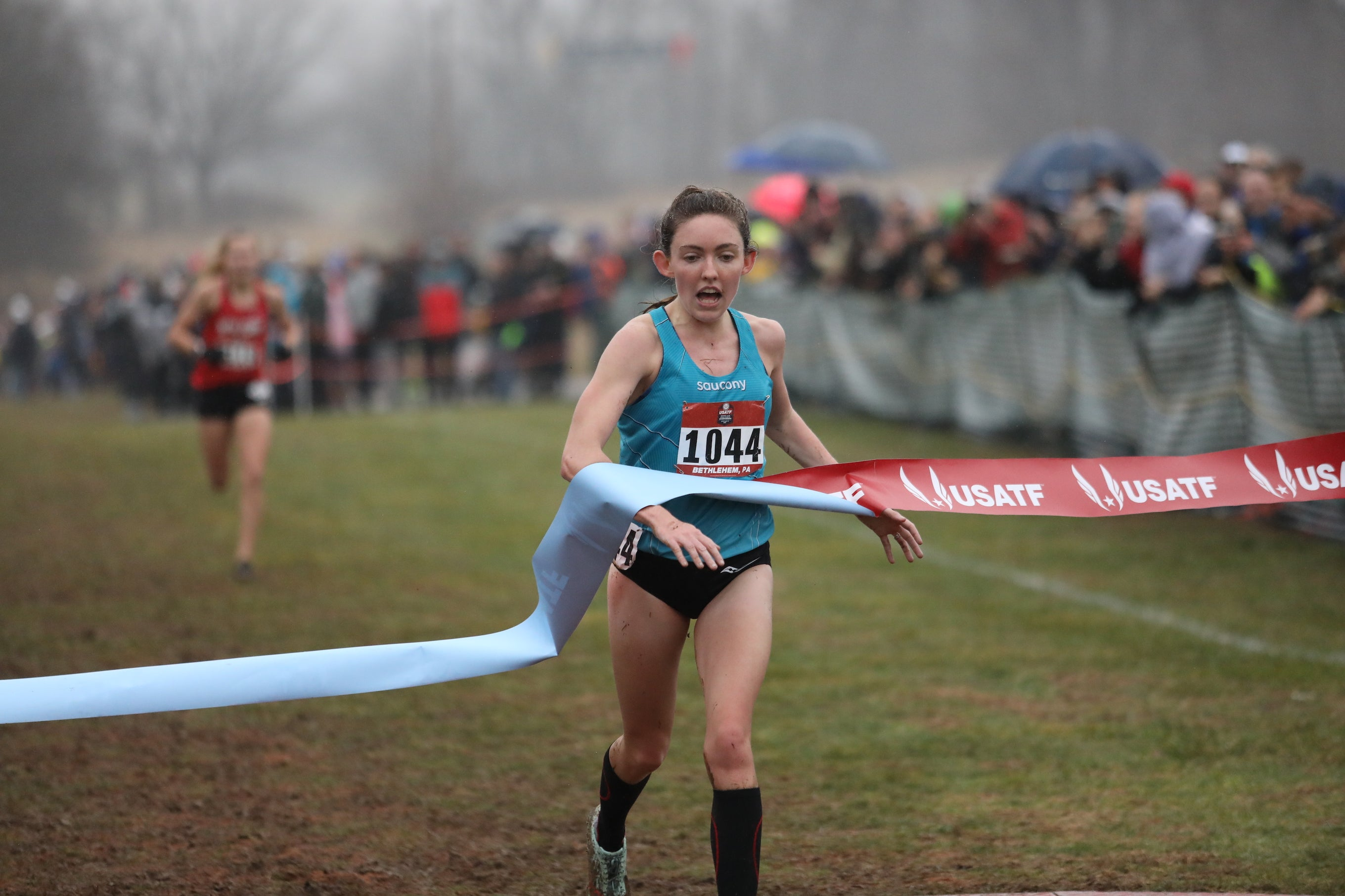 The 2019 USATF Club Cross Country open women's champion Aisling Cuffe, 26, breaks the tape at Lehigh University, representing Saucony.