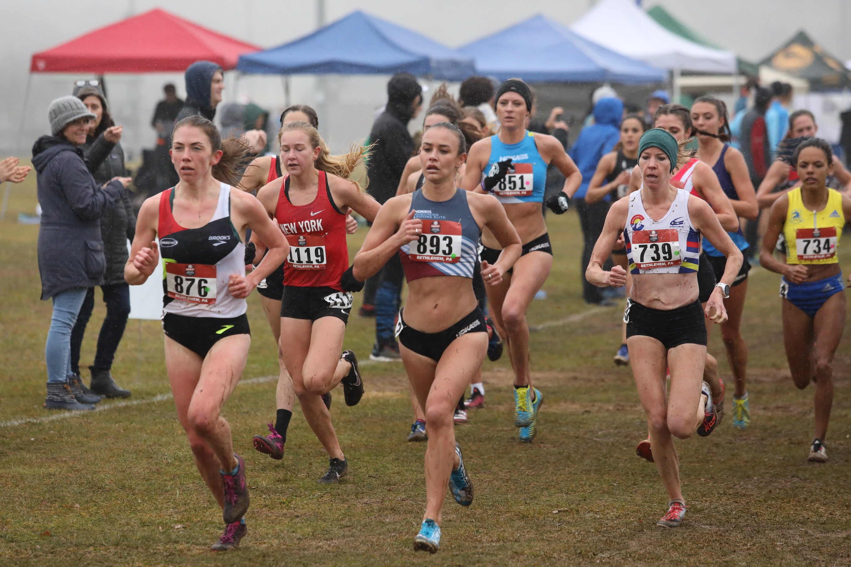 The early lead pack at the 2019 USATF Club Cross Country Championships includes Olivia Pratt (bib 876), Danielle Shanahan (bib 893), Melissa Dock (739), Katelyn Tuohy (1119), and Leah O'Conn0r (851).