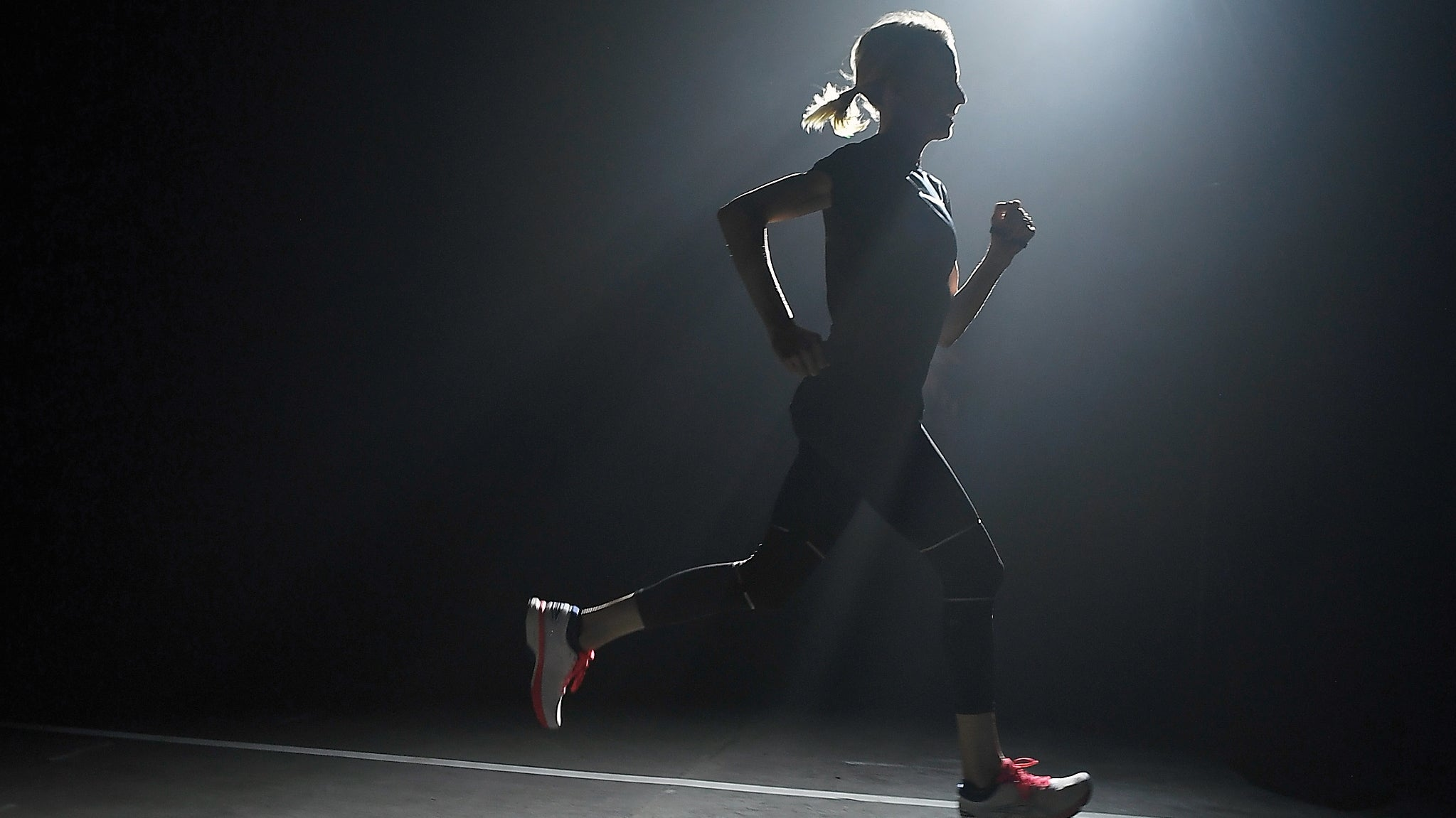 Woman running in the dark