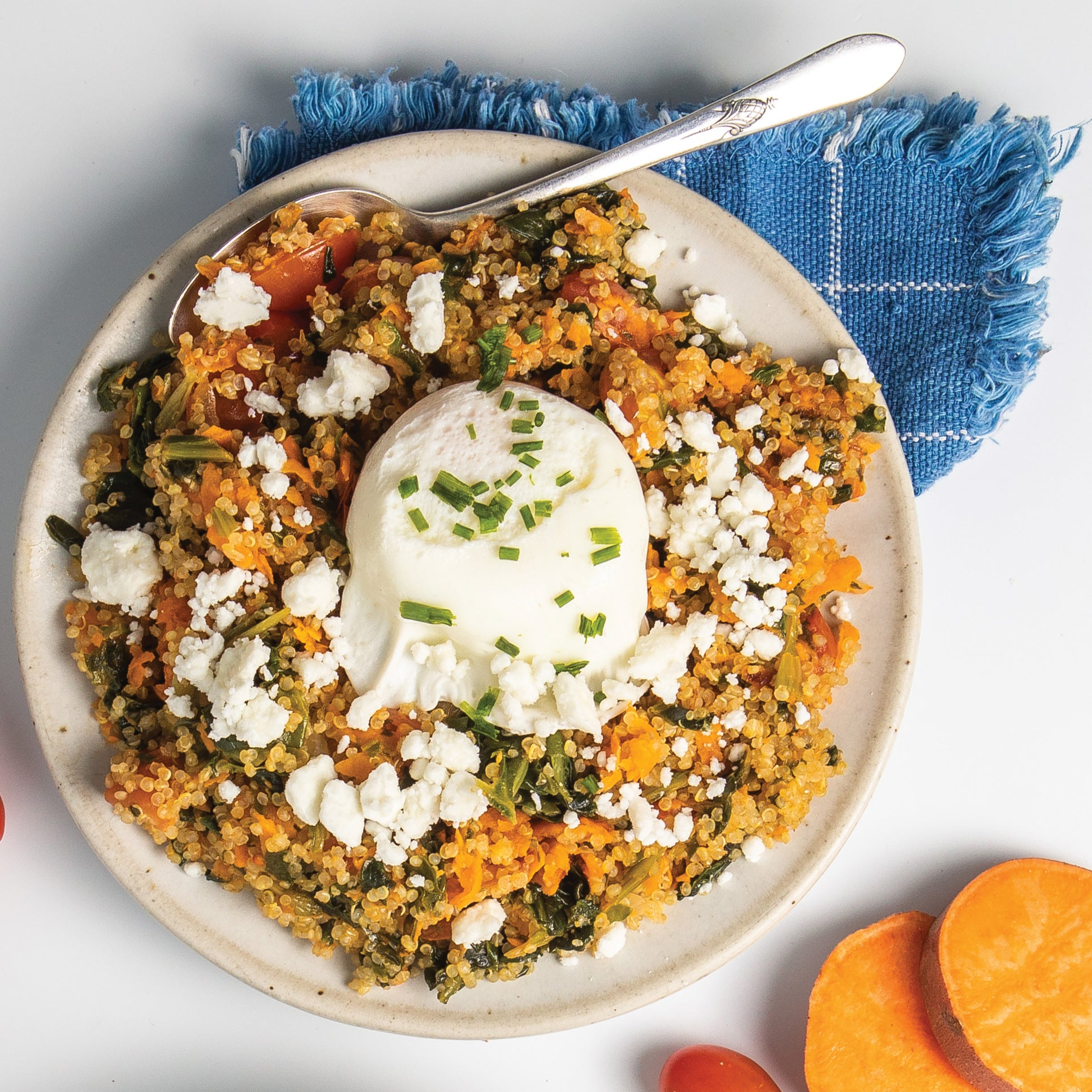 An egg recipe that includes sweet potato quinoa bowl with poached egg on top