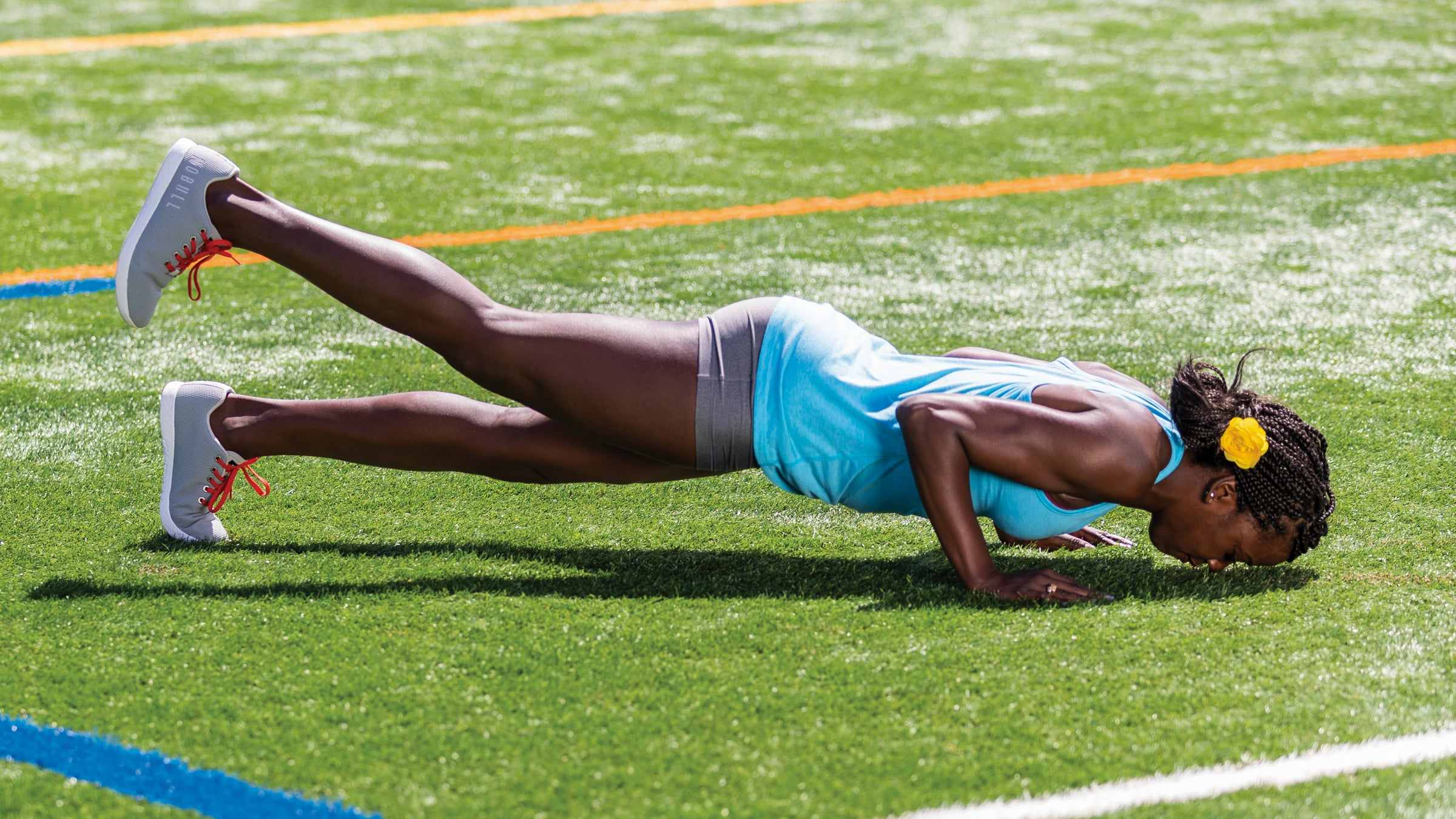 Alysia Montano demonstrating a push up with leg lift