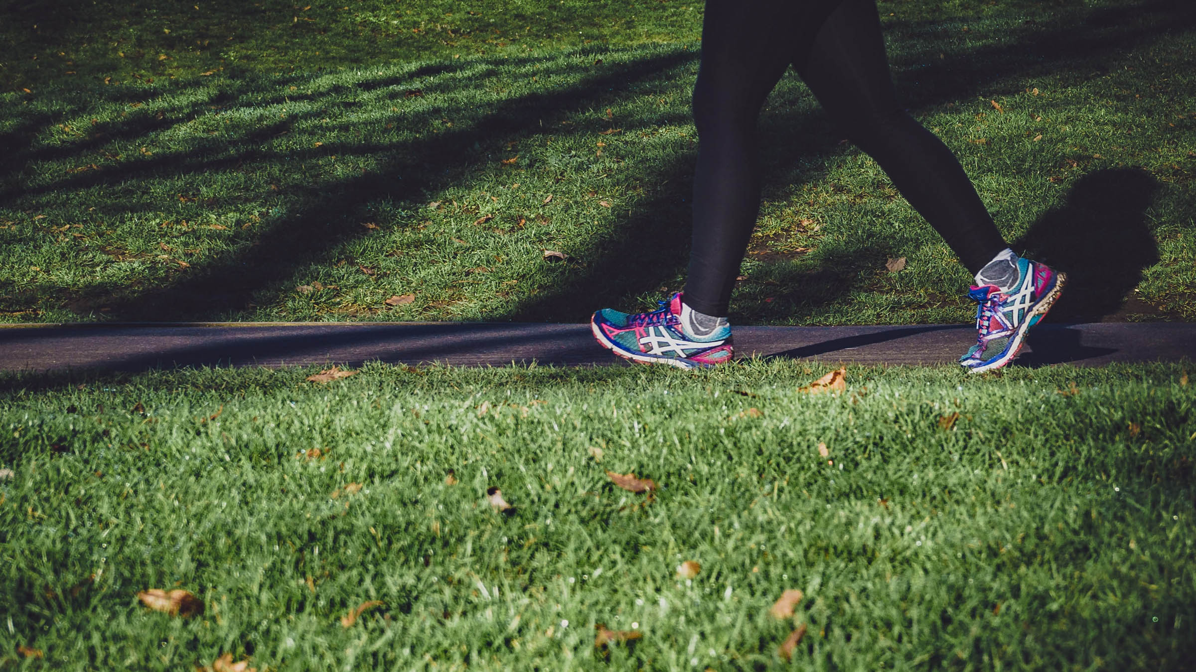 Woman run/walking on a sidewalk
