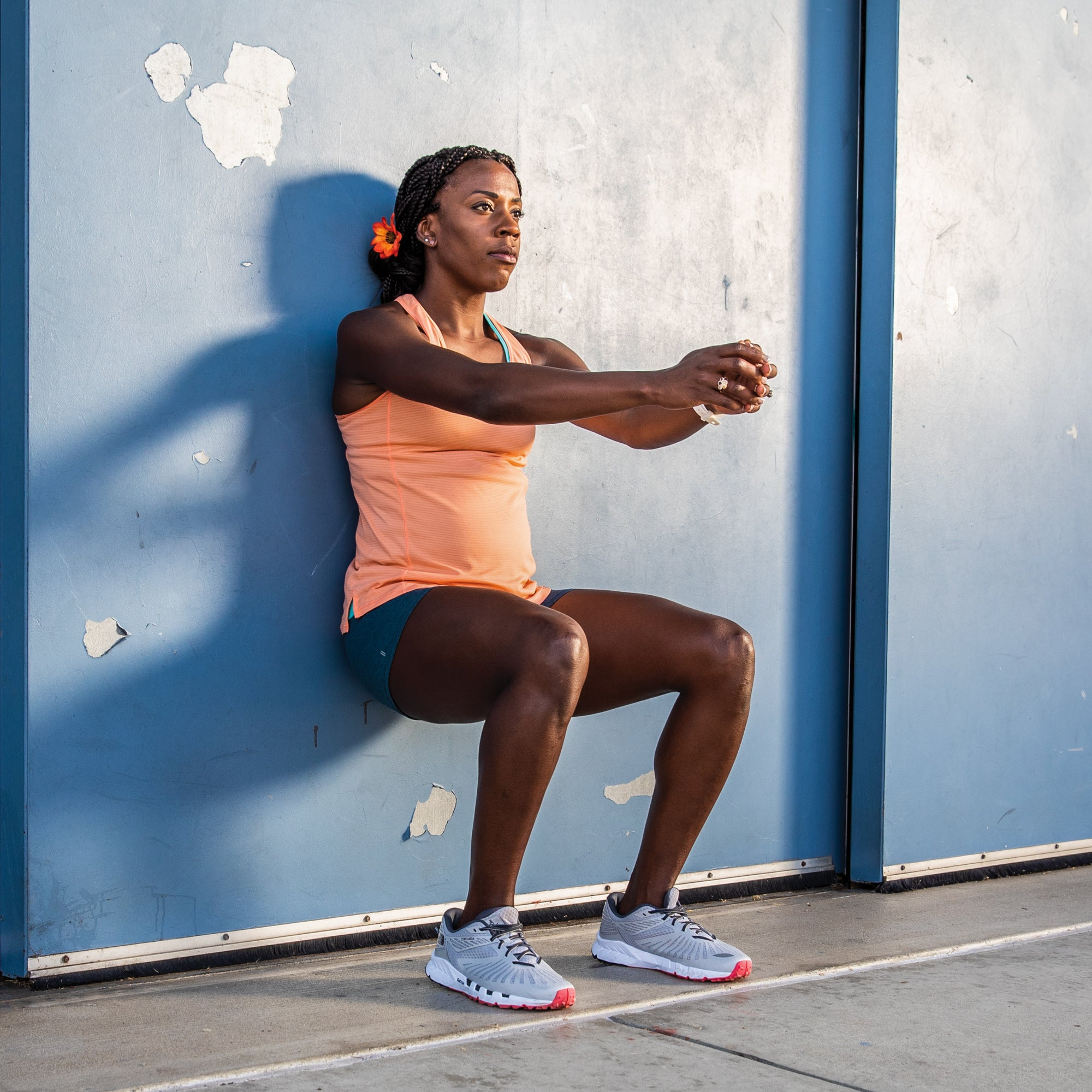 Alysia Montano demonstrating a wall sit