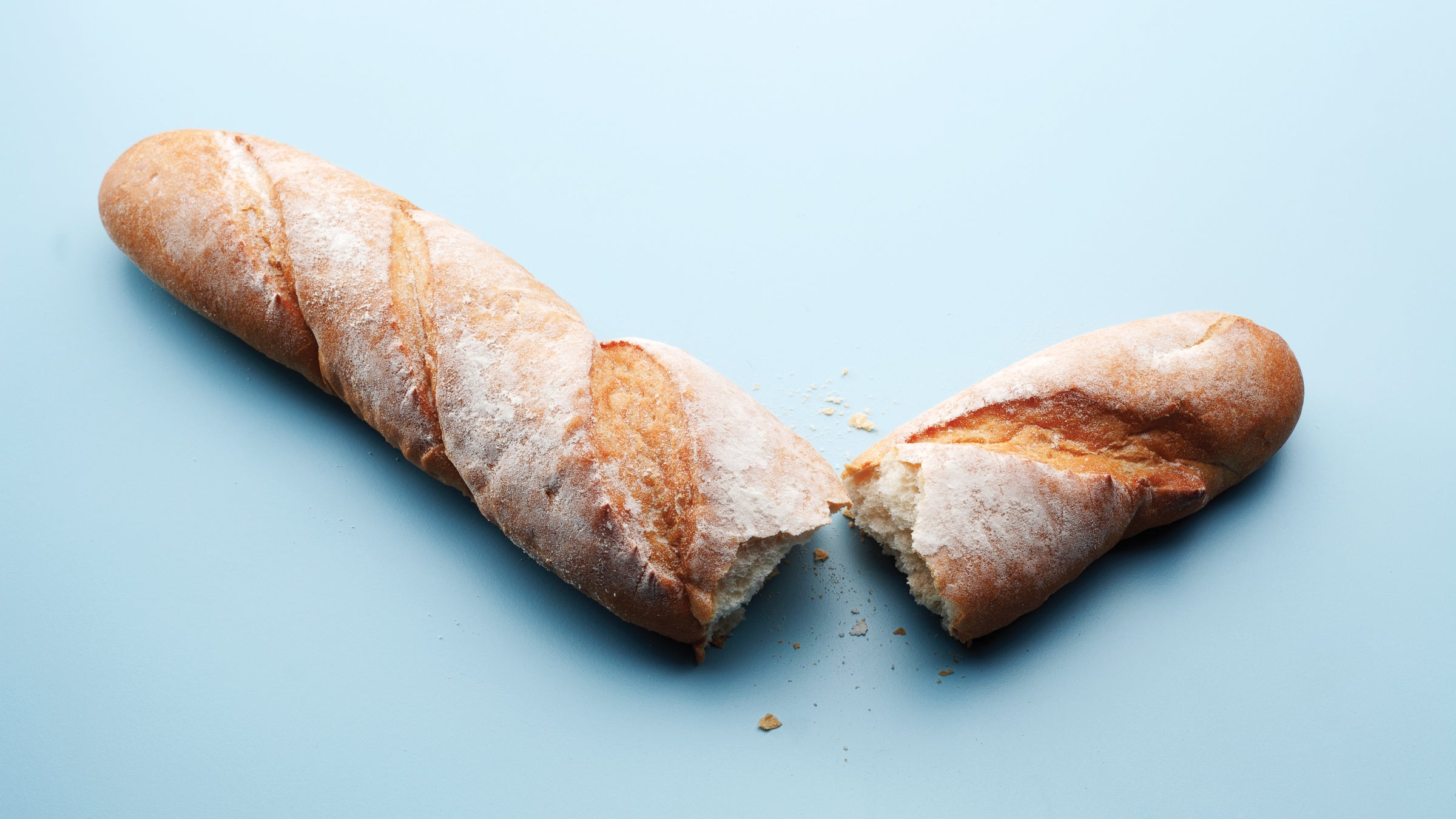 Baguette torn into two pieces