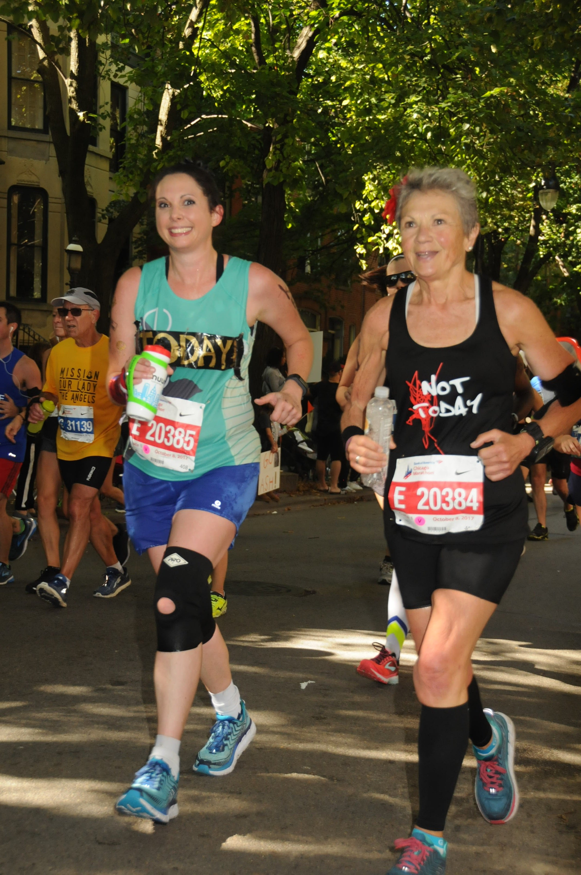 Kelly Herron and her mom run together during a race