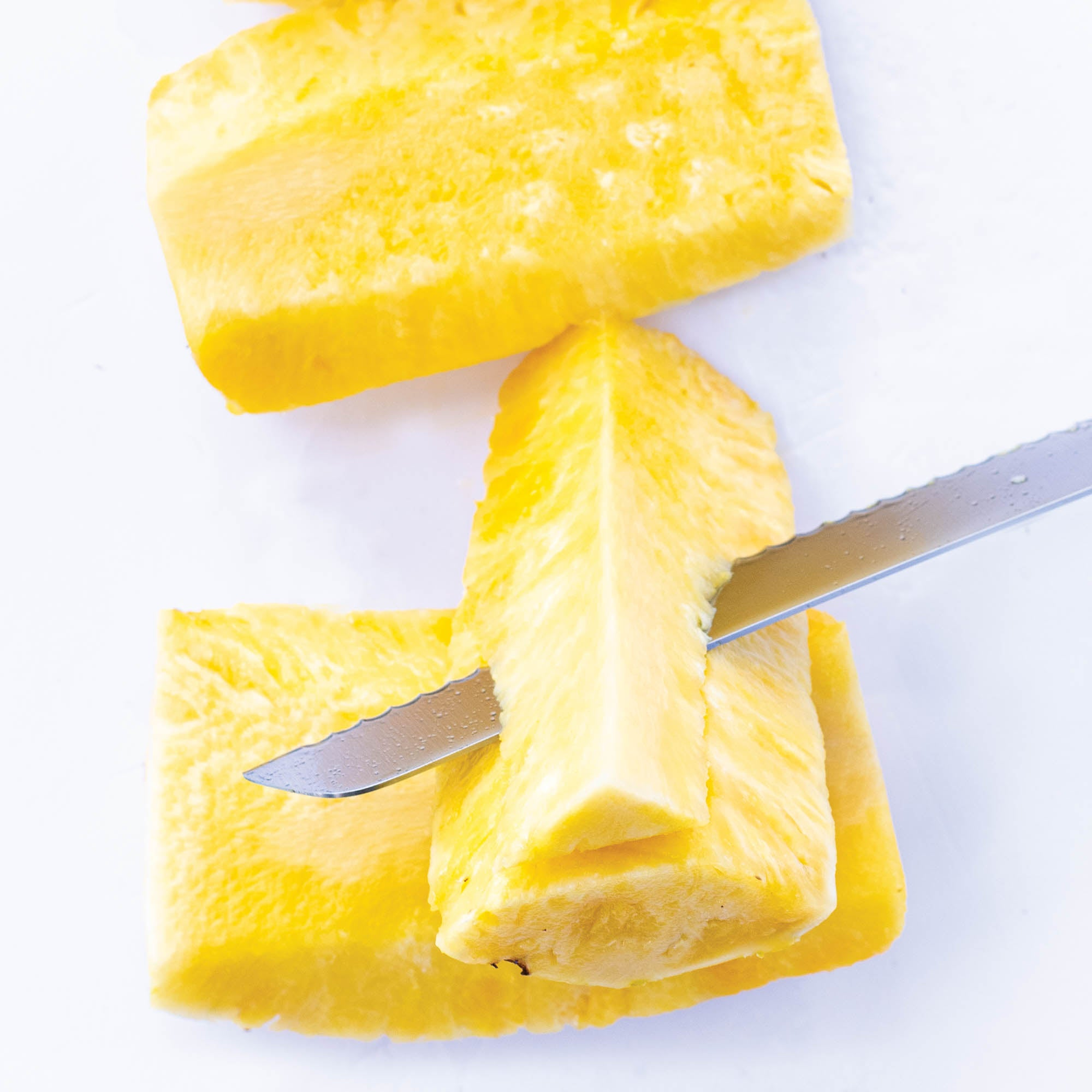 Trimming pineapple core