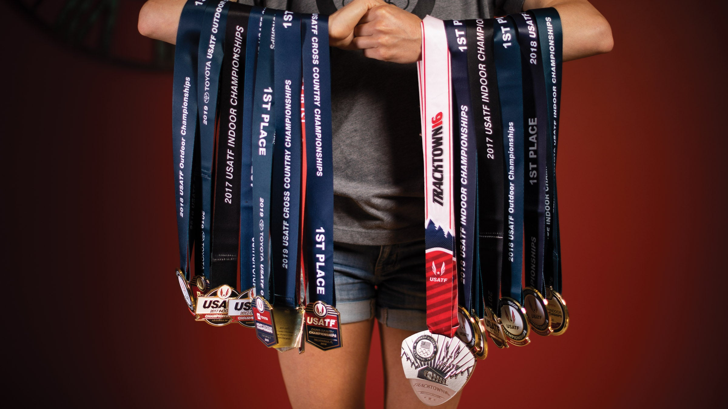 Shelby Houlihan holds her medals