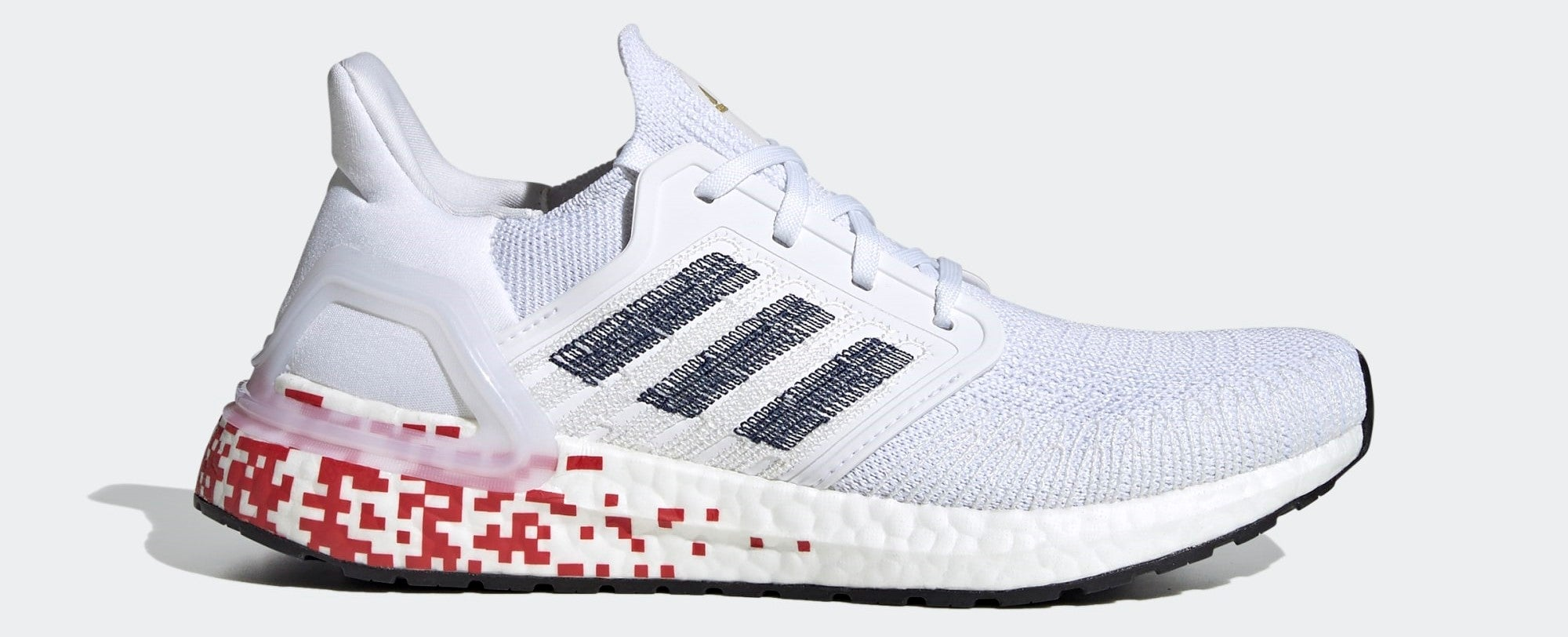 All-white running shoe with red pixels on back of sole and blue adidas logo