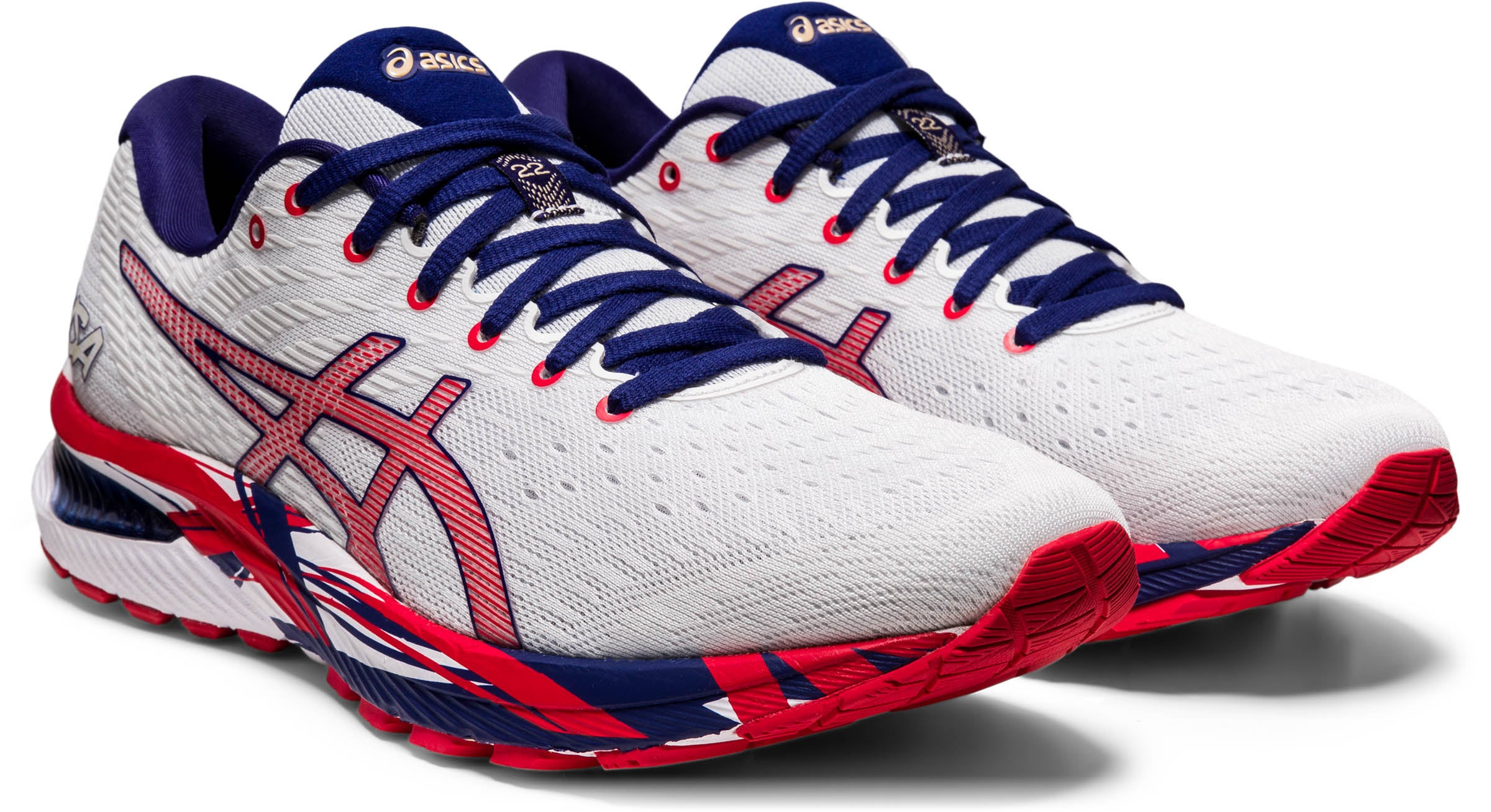 White running shoes with blue laces, red logo, and red and blue soles