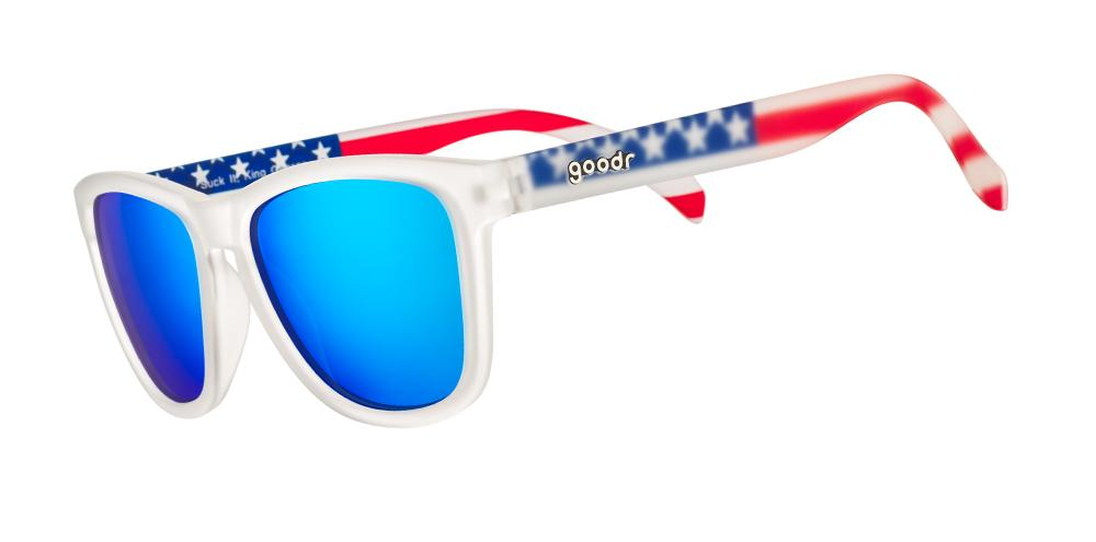 Sunglasses with blue lenses, white frames, and American flag-pattern arms