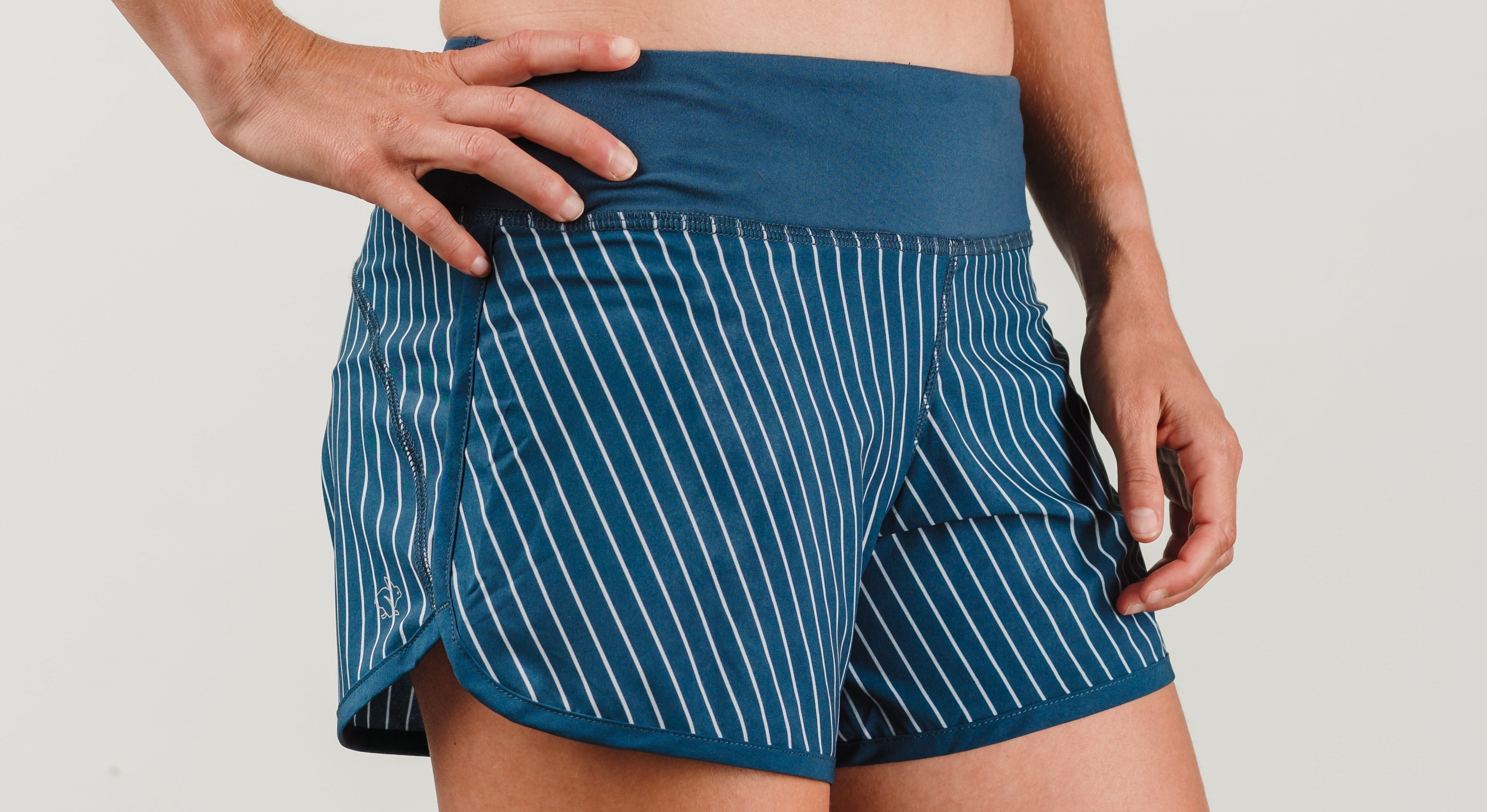 Blue running shorts with white pinstriping