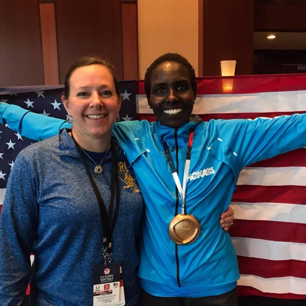 Jean Knaack congratulates 2020 Olympic Marathon Trials winner, Aliphine Tuliamuk.