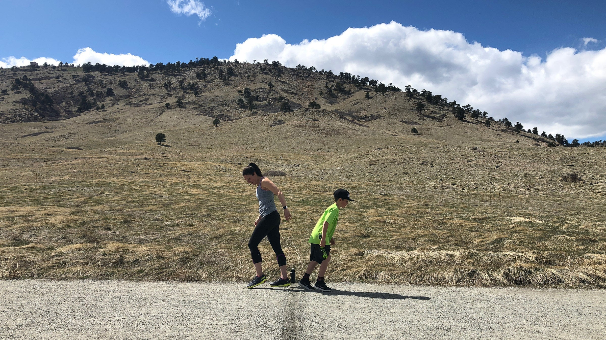Mother and son race on trail