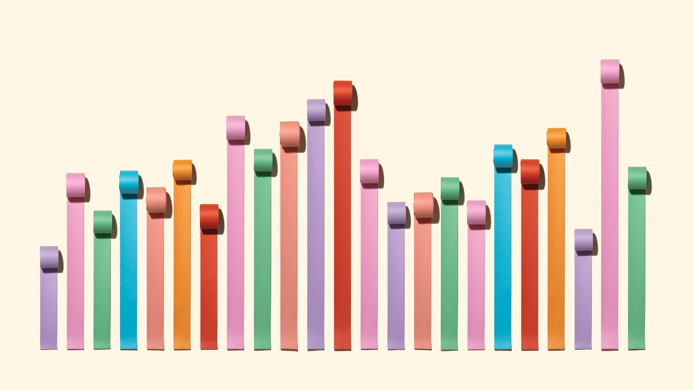Chaos Bar Chart Made of Paper Rolls on Solid Beige Background.