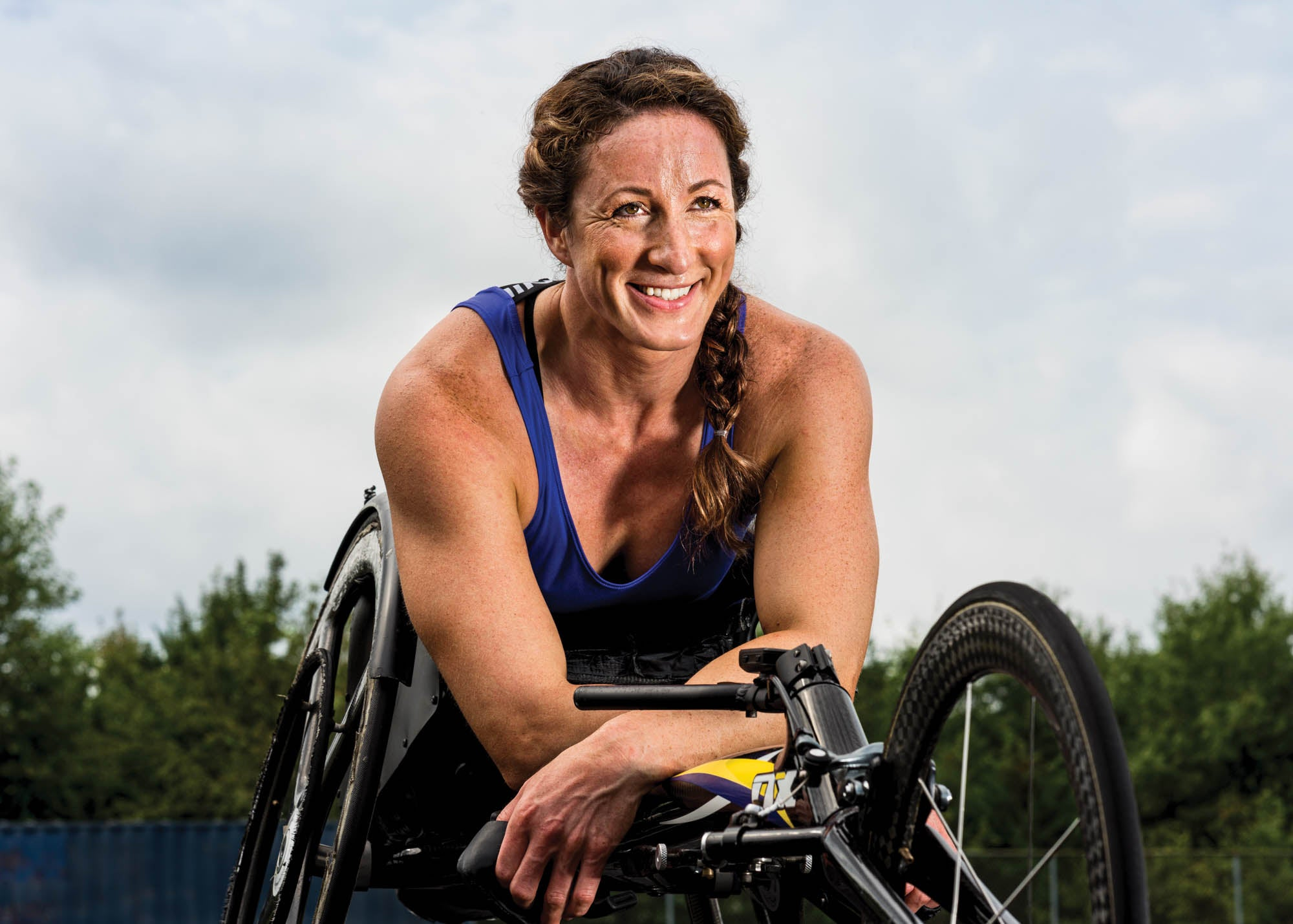 Portrait of McFadden outside in her racing wheelchair