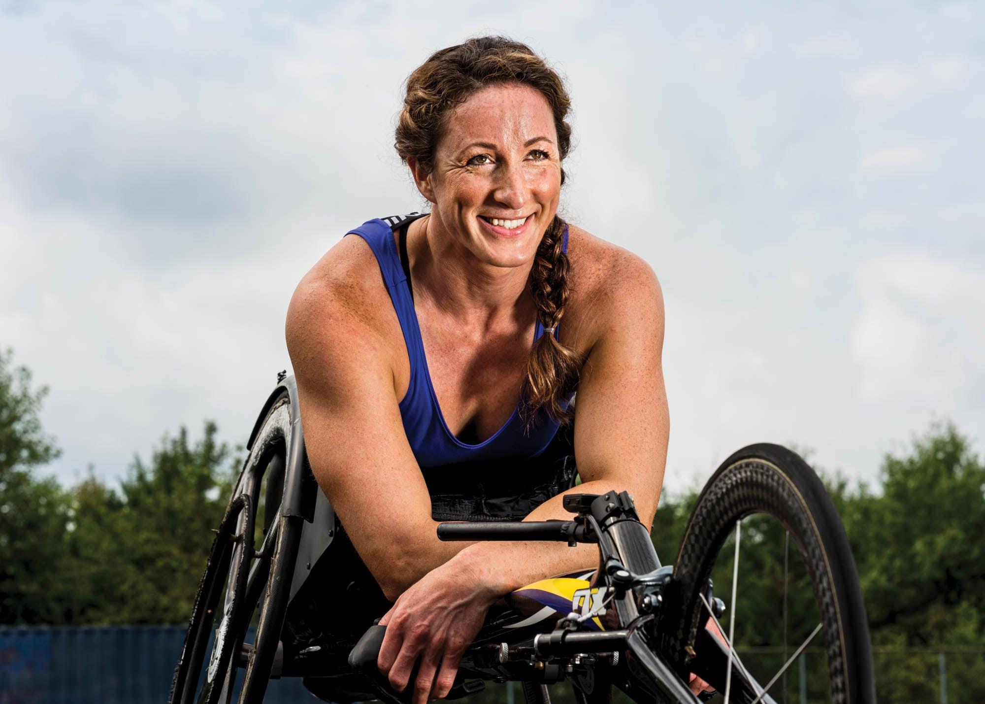 Portrait of McFadden outside in her racing wheelchair