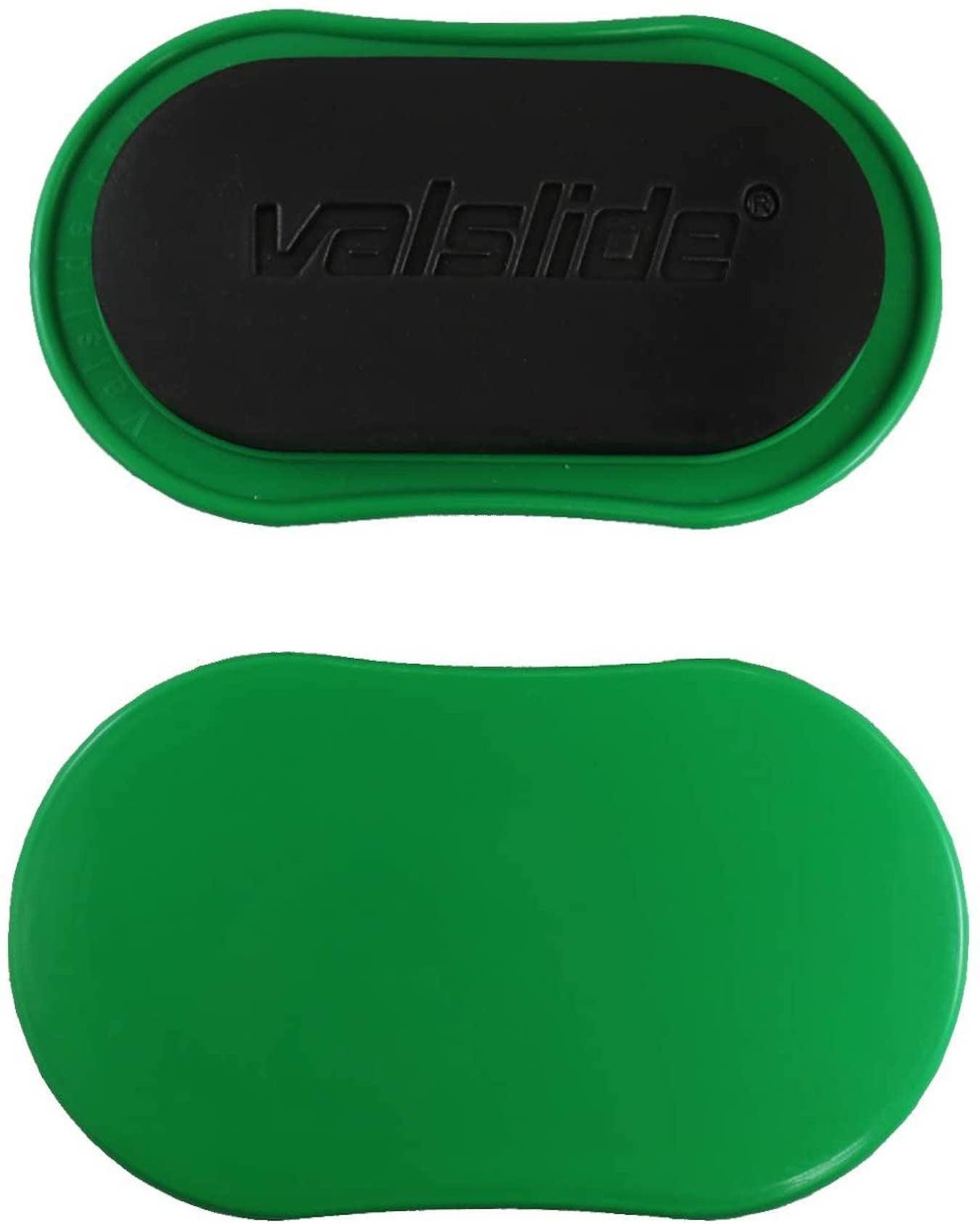 Un par de discos deslizantes Valslide verdes para entrenamientos en casa