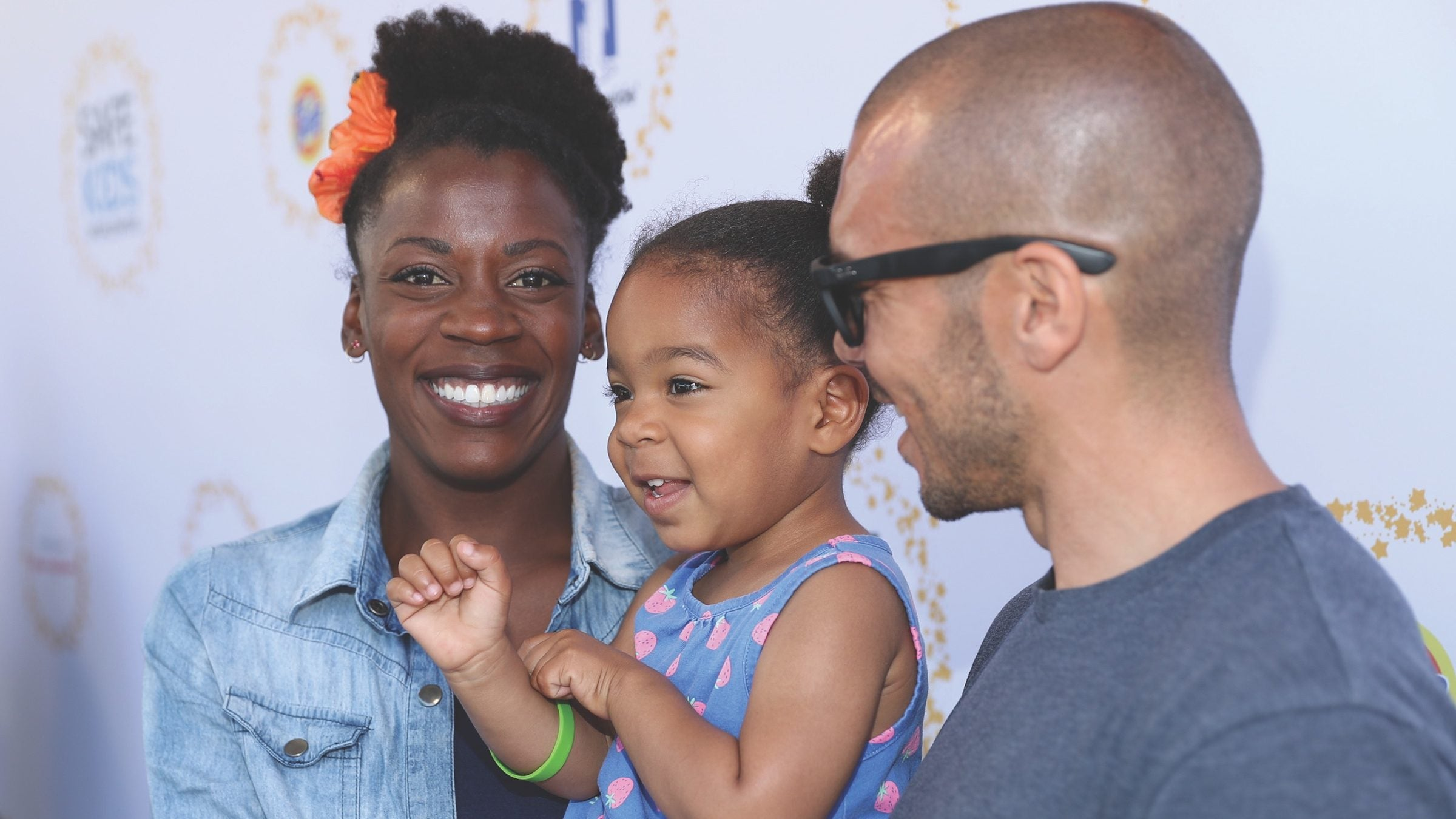 Alysia Montano poses with her daughter and husband