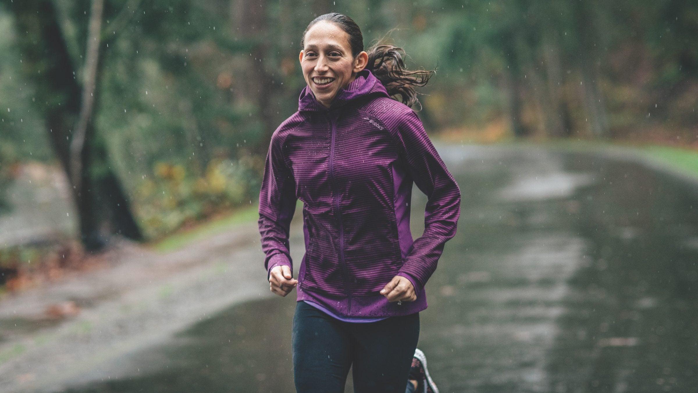 Desiree Linden running on a rainy road
