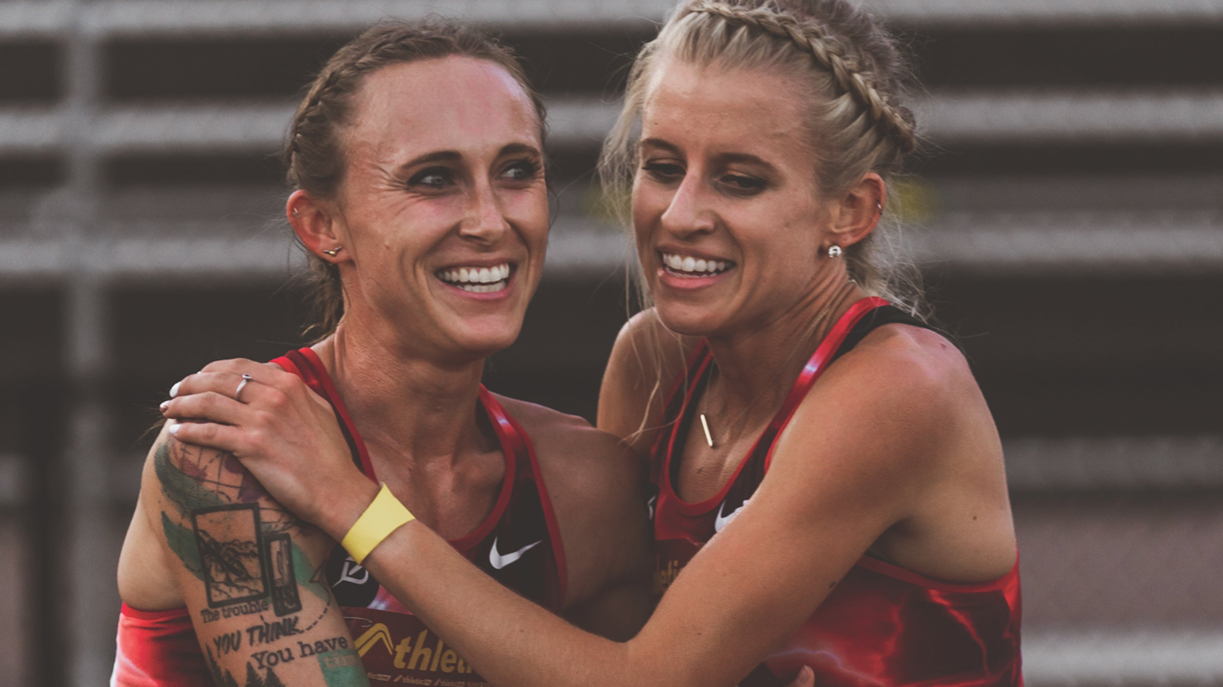 Shelby Houlihan and Karissa Schweizer hug after a race in 2020