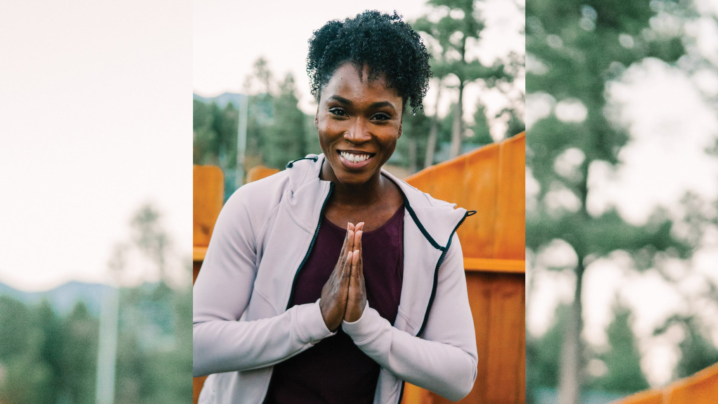 Tianna Bartoletta poses with her hands in prayer pose